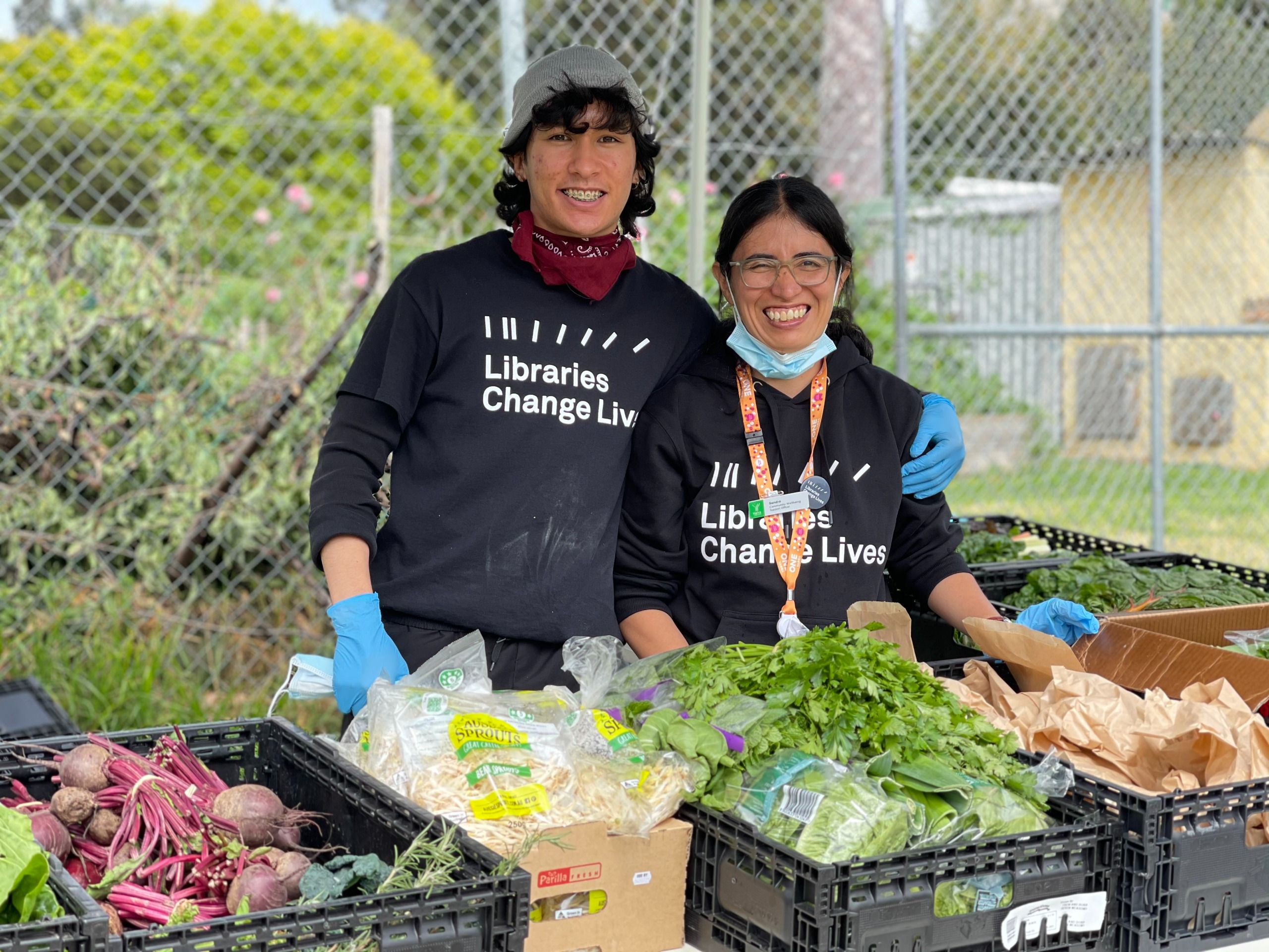 two workers with food for community relief