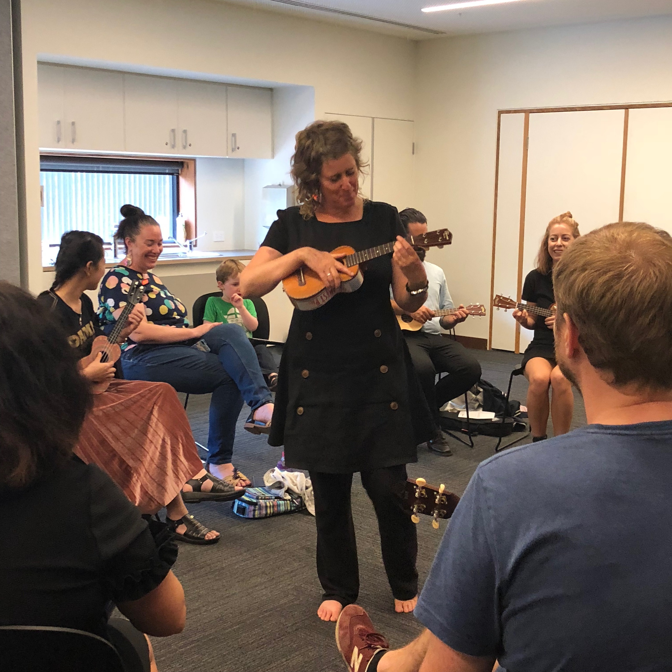 person teaching Ukelele at library workshop