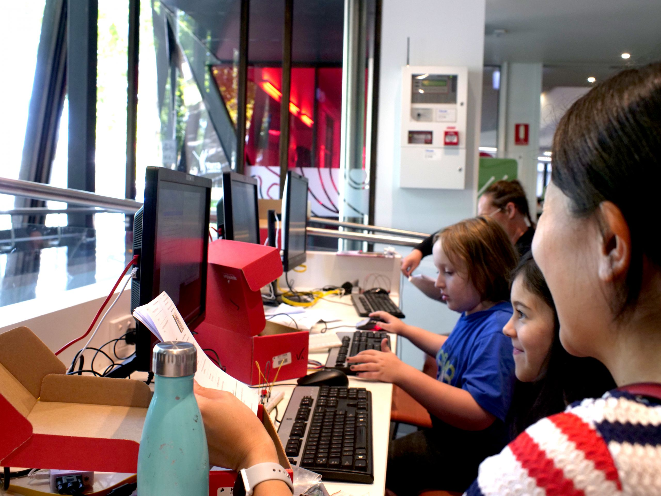children in makers club using computers at library