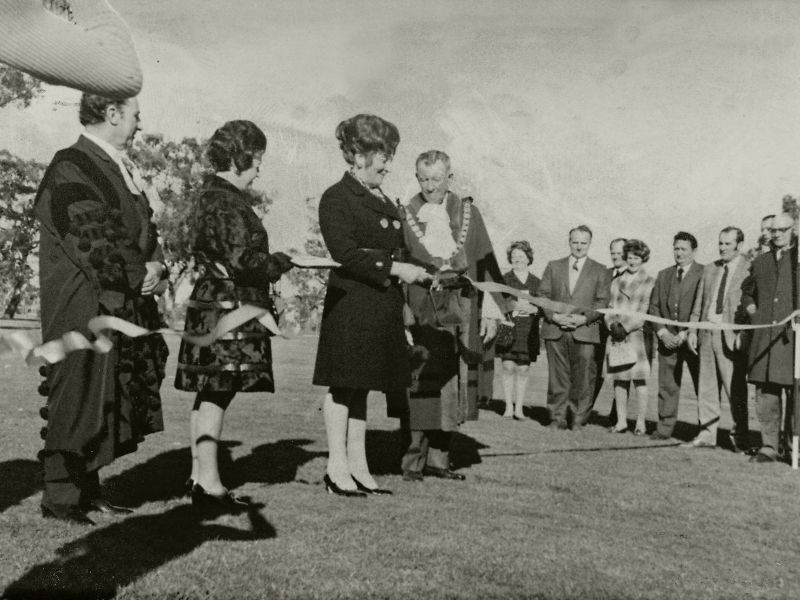 Black and white photo of people at the opening of Burnley Golf Course.