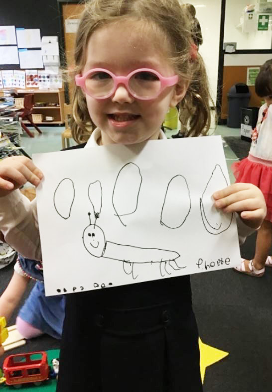 igs-early-learning-student-with-insect-drawing