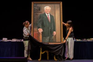 Unveiling of the portrait of Reg St Leon at 2018 Speech Night