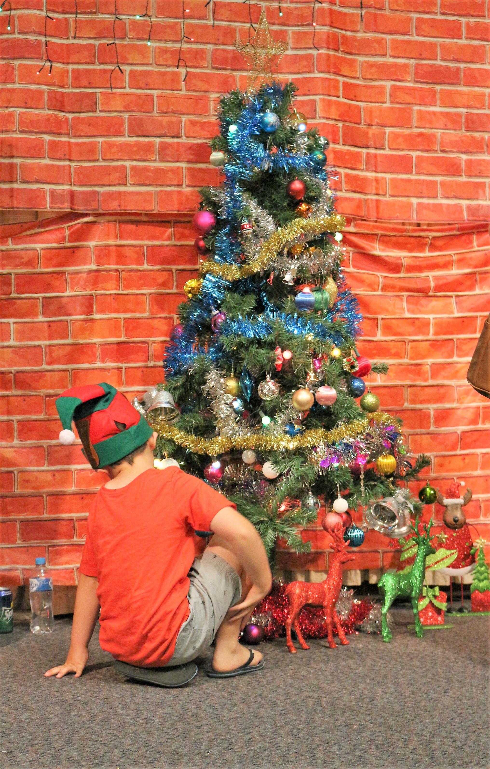 Kid under the Christmas tree