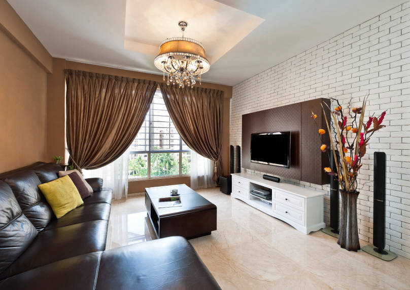 the living room of this 3room condominium has a similar layout to the first home but this time the brick wall is the star it stretches across the entire