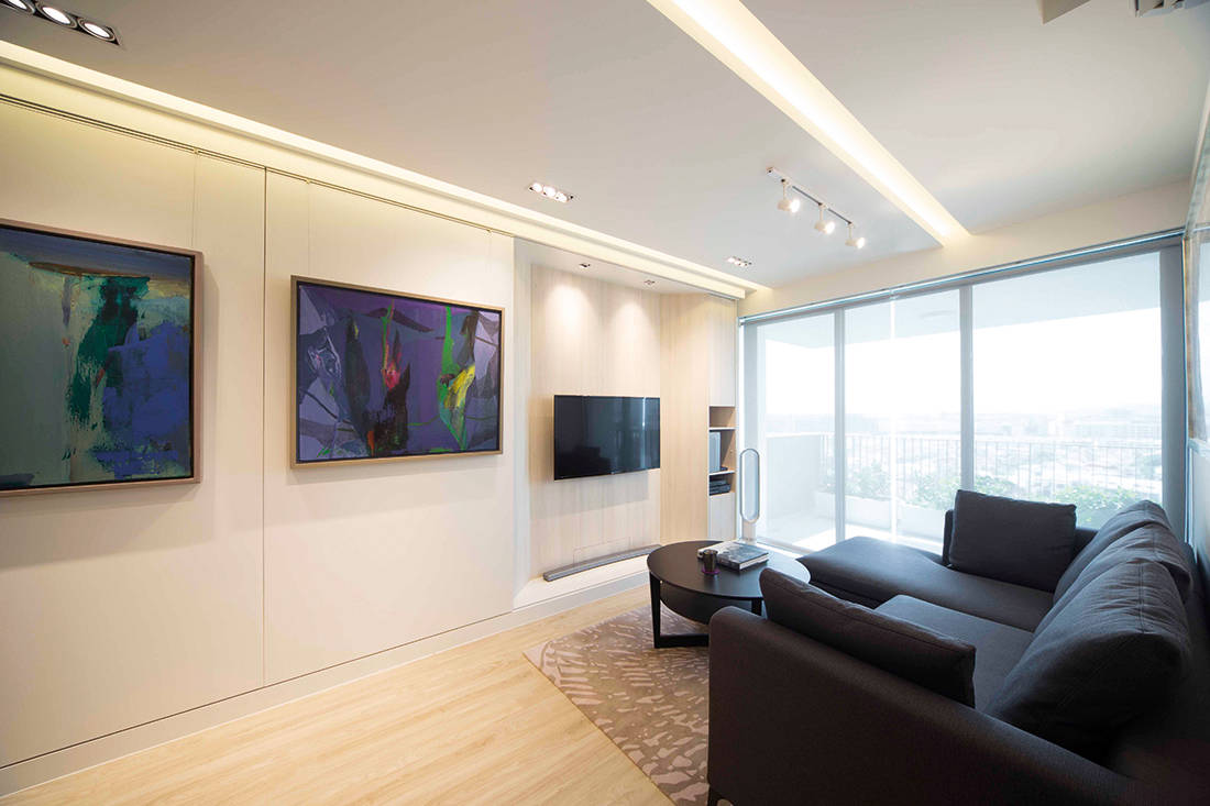 See how sliding walls in this apartment transform the living room ...