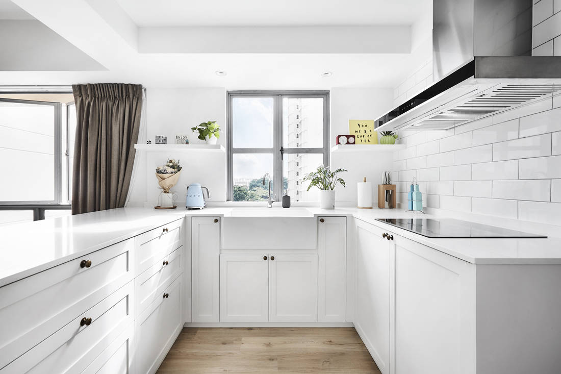 Third Avenue Studio Aquarious by the Park all-white interior kitchen with Shaker style cabinets