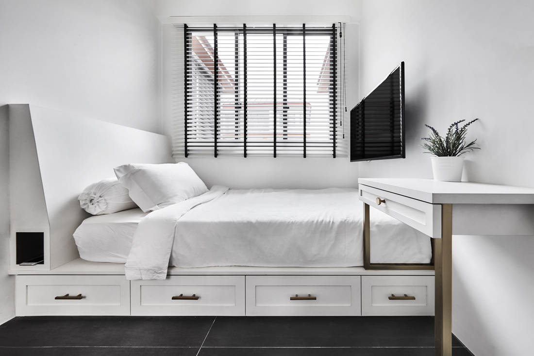 Custom bedframe with storage space beneath designed by Third Avenue Studio - Floraview project