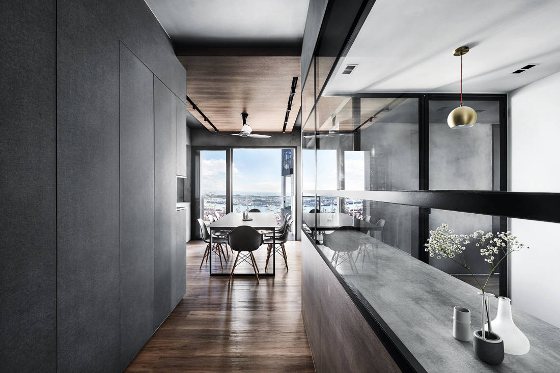 IN-EXPAT moody & masculine condo kitchen and dining area