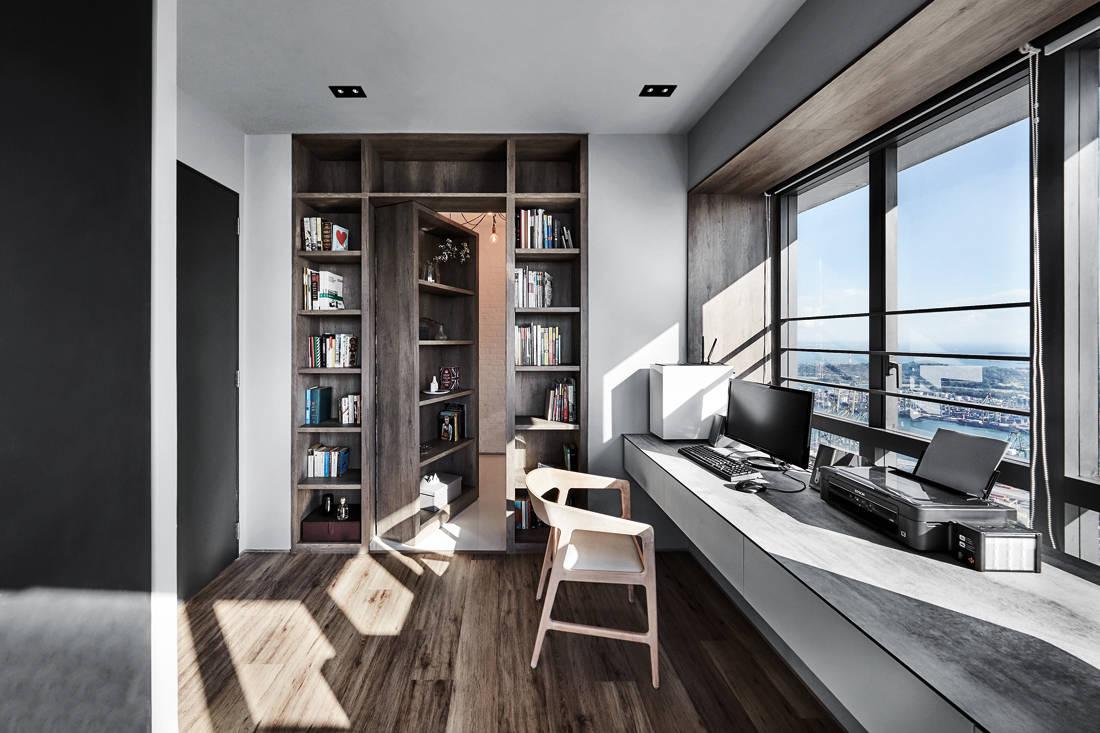 IN-EXPAT moody & masculine condo study and non-descript bookshelf