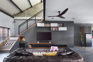 Pre-war apartment turned industrial loft living room designed by Prozfile