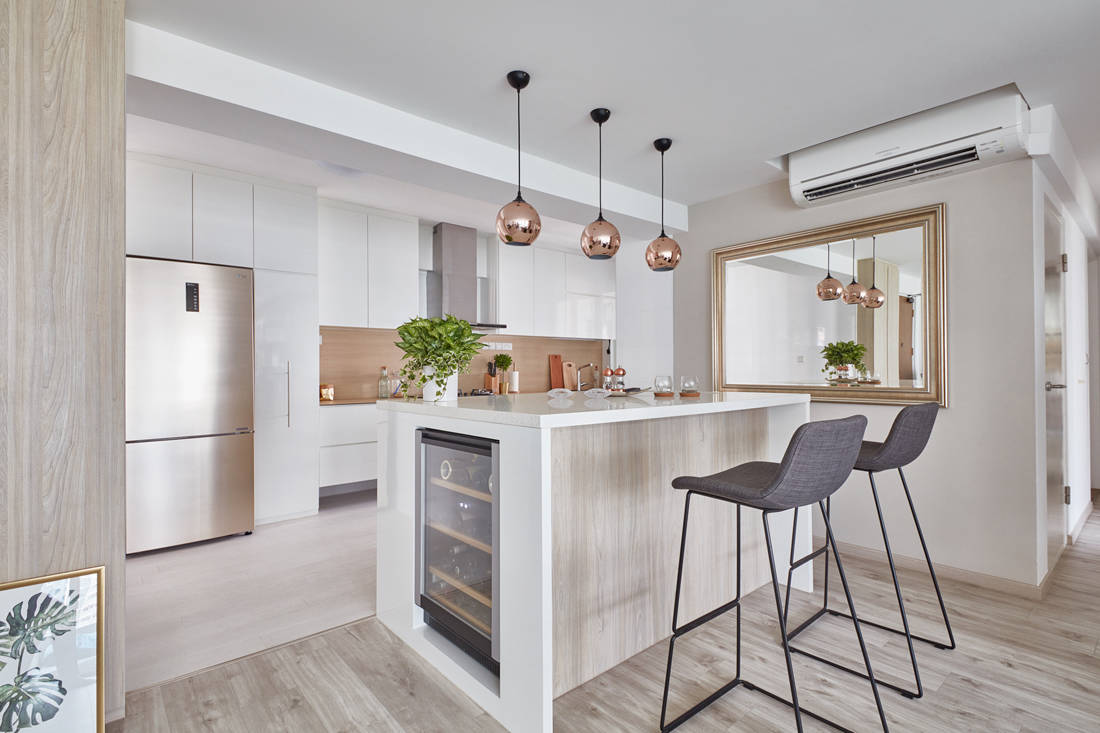 integrated wine chiller within the kitchen island create extra storage space in a condo designed by Free Space Intent