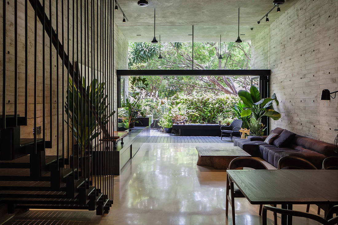 Living room of Open House by Formwerkz Architects embraces nature