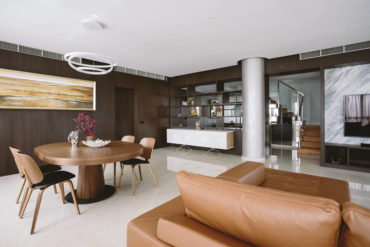 Structural columns enhance this hotel-inspired penthouse