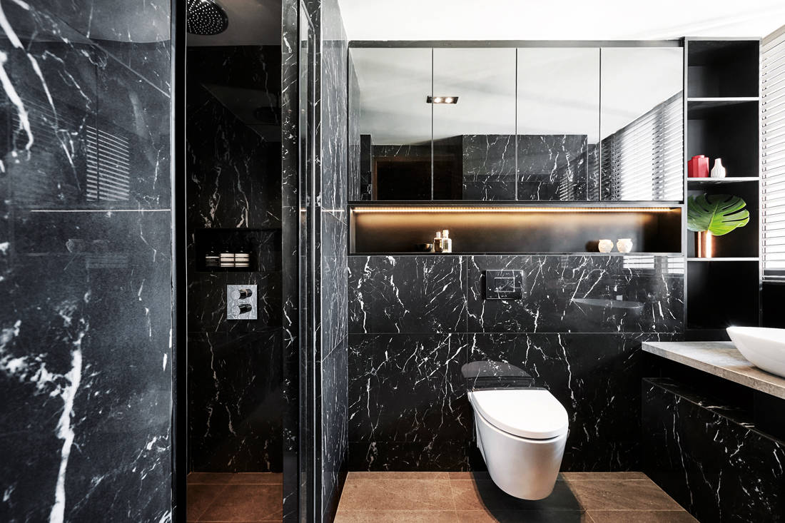 luxe and dramatic condo bathroom by IN-EXPAT
