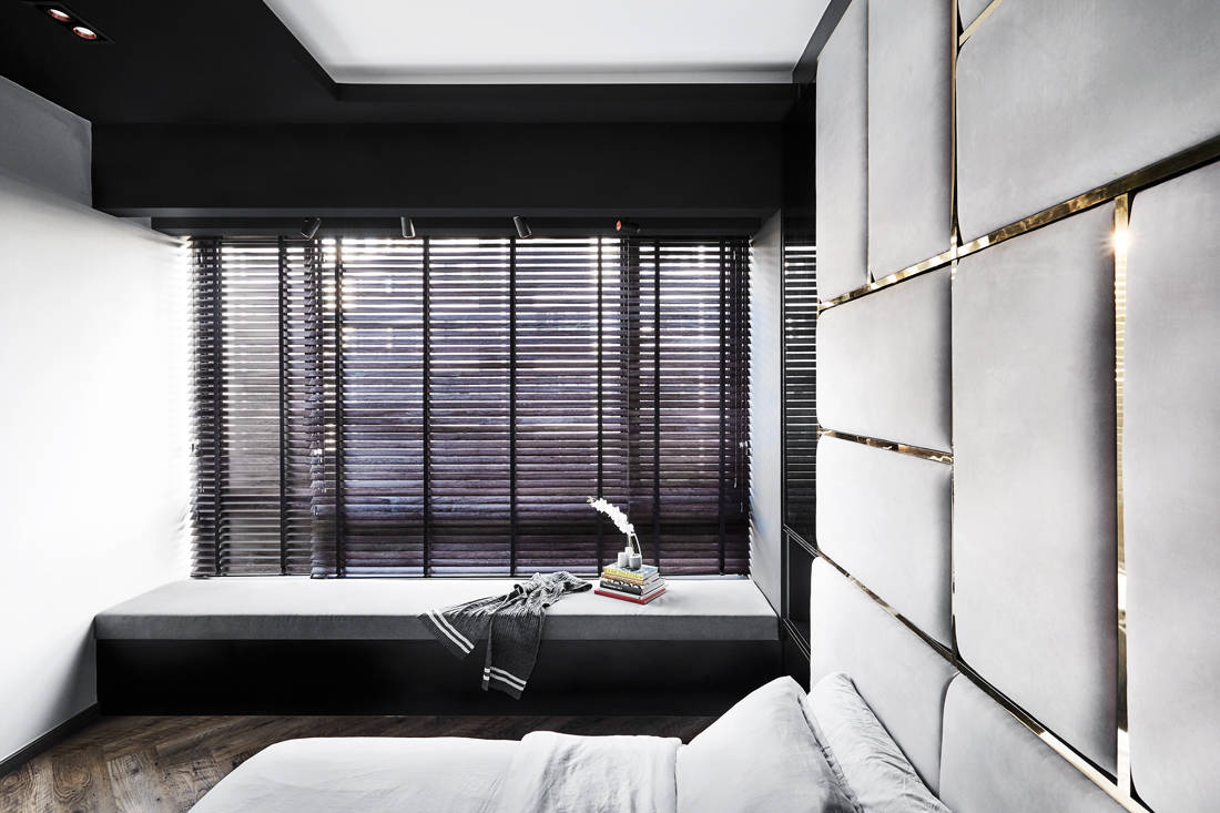 luxe and dramatic condo bedroom by IN-EXPAT