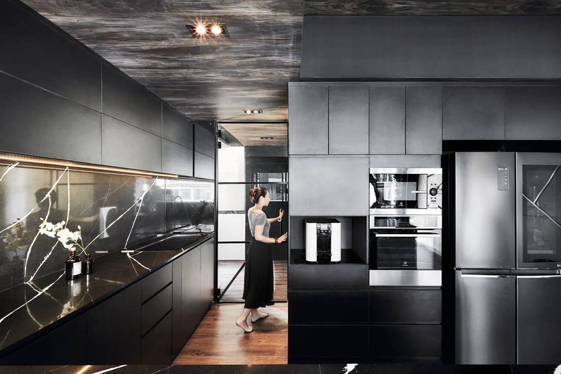 luxe and dramatic condo kitchen by IN-EXPAT