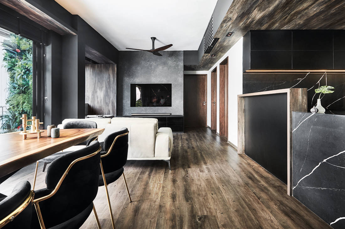 luxe and dramatic condo living space by IN-EXPAT