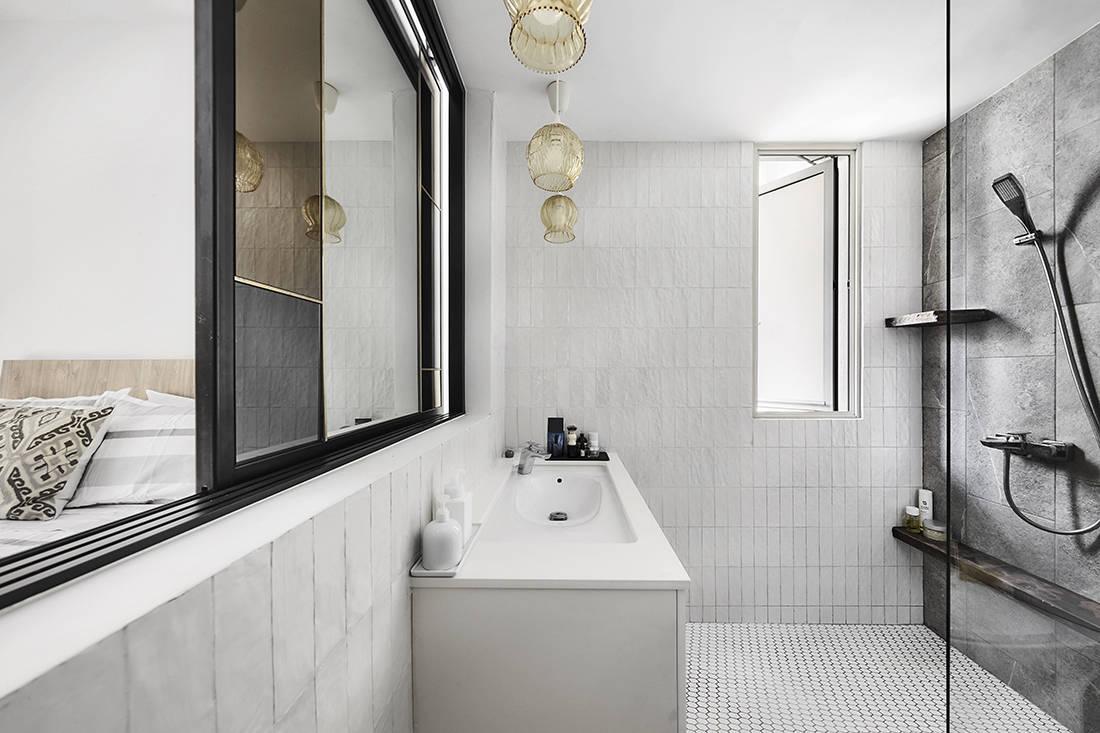 tropical oasis family home master bathroom designed by Third Avenue Studio