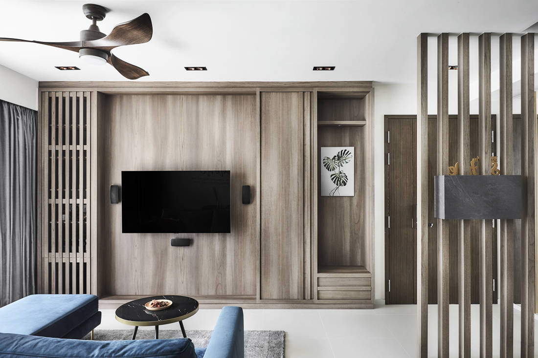 wood and steel accents in condo feature wall by Couple Abode