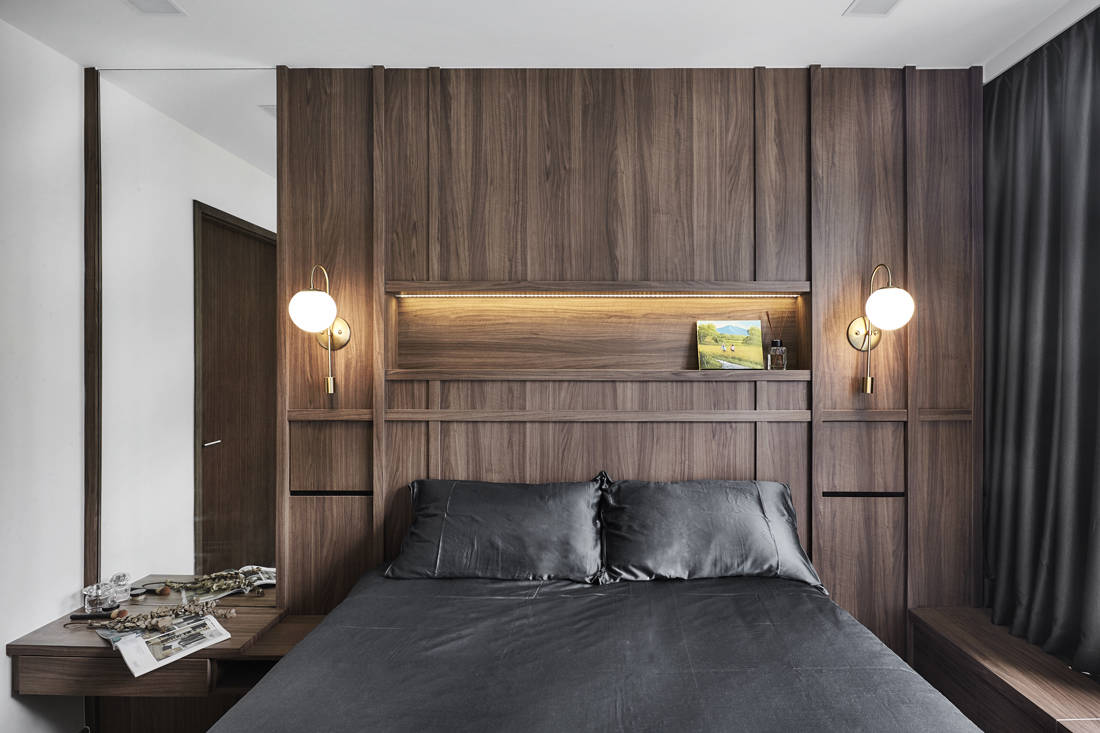 wood and steel accents in condo master bedroom by Couple Abode