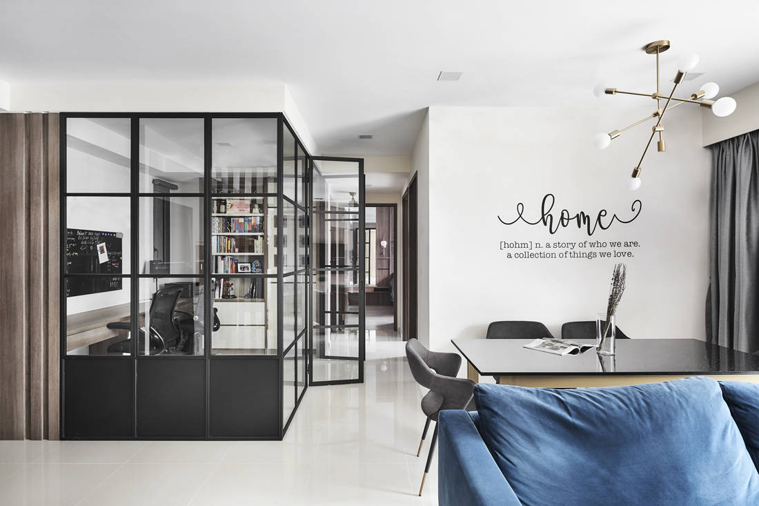 wood and steel accents in condo study by Couple Abode