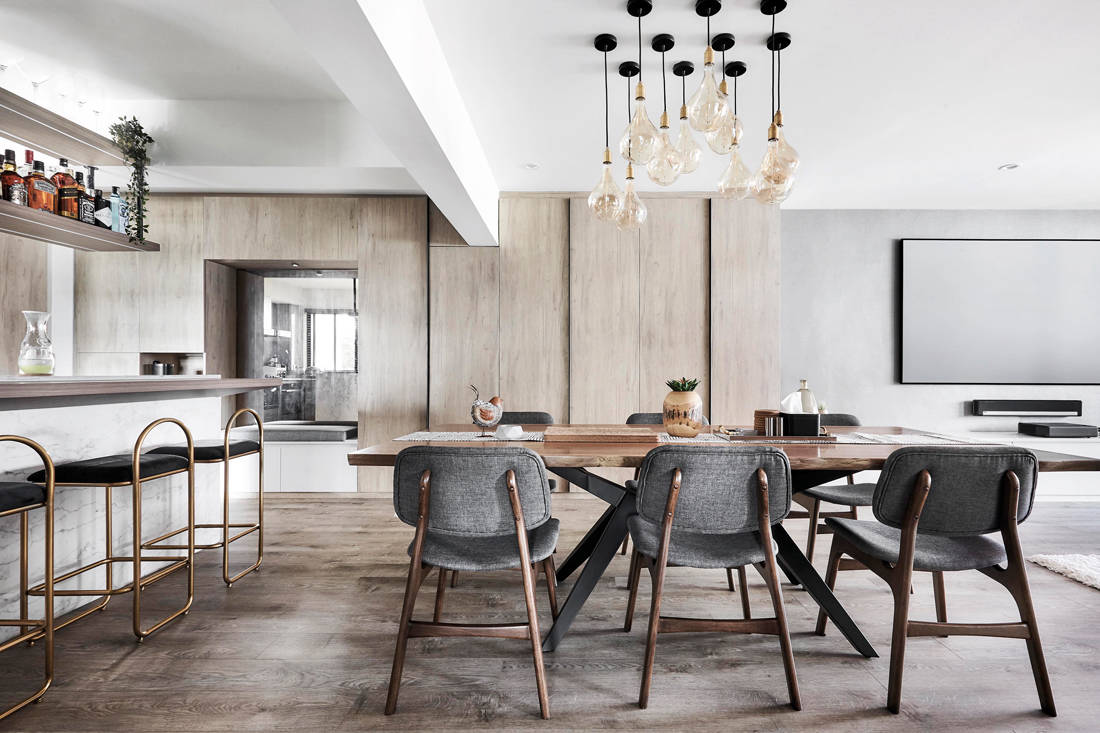 dining room of resort inspired resale flat with Hollywood-style makeup studio by Design Zage