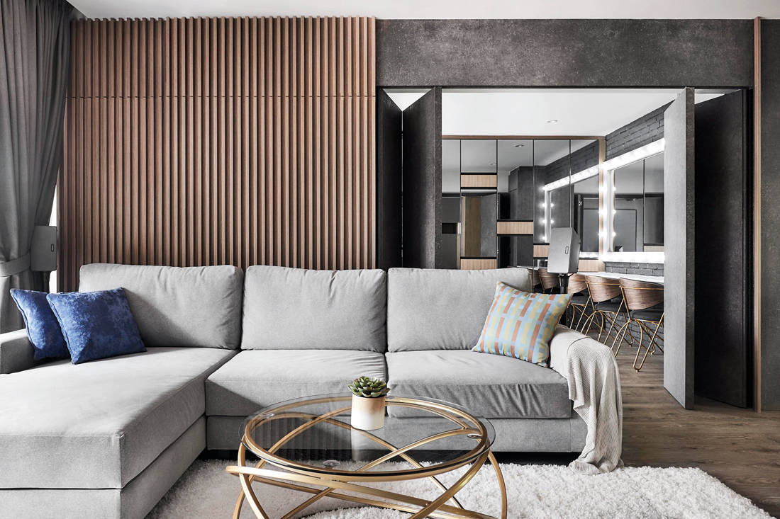 living room of resort inspired resale flat with Hollywood-style makeup studio by Design Zage