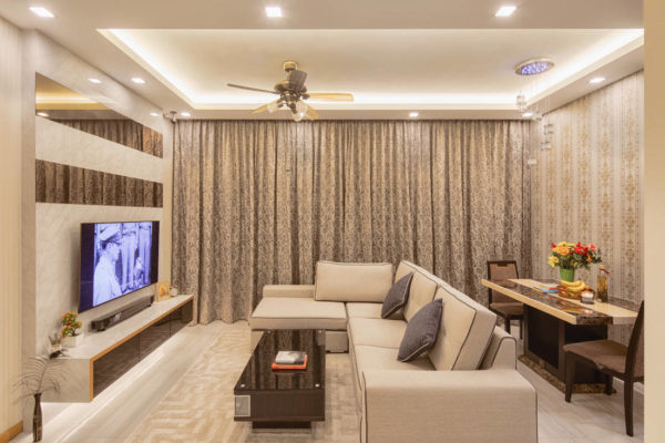 marble and mirror accents in condo living room by AP Concept