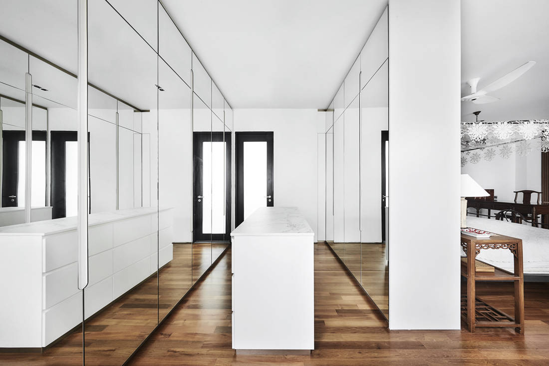 modern Oriental-style walk-in wardrobe by Third Avenue Studio