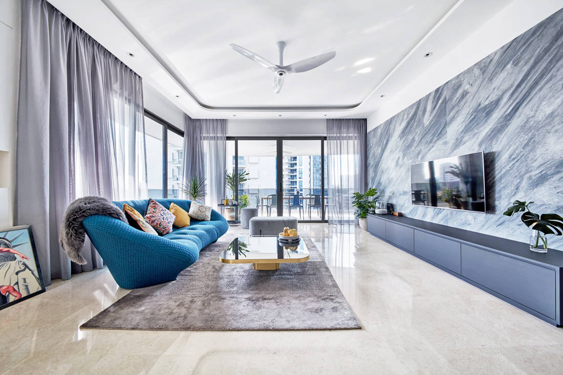 use of marble in living room of Trilight condo by Free Space Intent