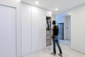 home with wardrobe outside the bedroom by Metier Planner