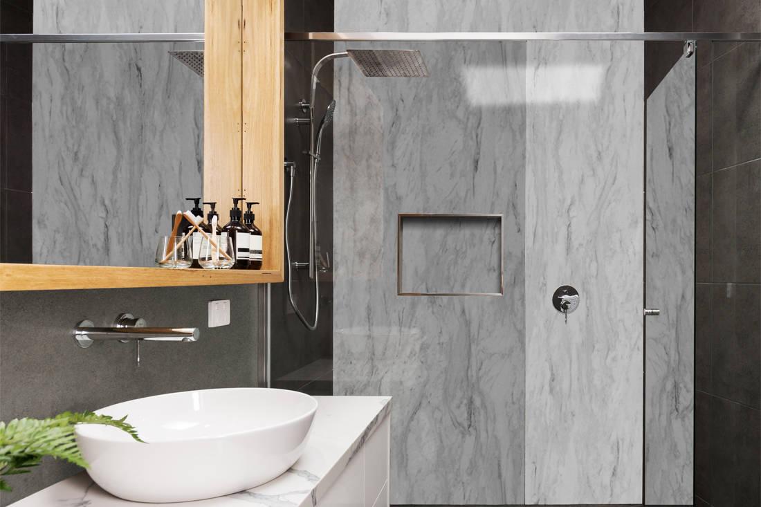 bathroom wall clad in Admiral Cerarl Concrete Corona laminate