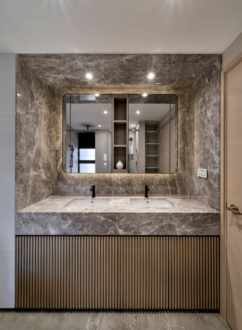 Even their bathroom makes a bold departure from the rest of the apartment with its fun pairing of colourful terrazzo surfaces and hexagonal tiles.