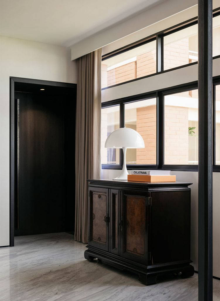 foyer with rose wood cabinet