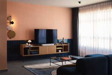 This  BTO flat is a visual smorgasbord of bold finishes