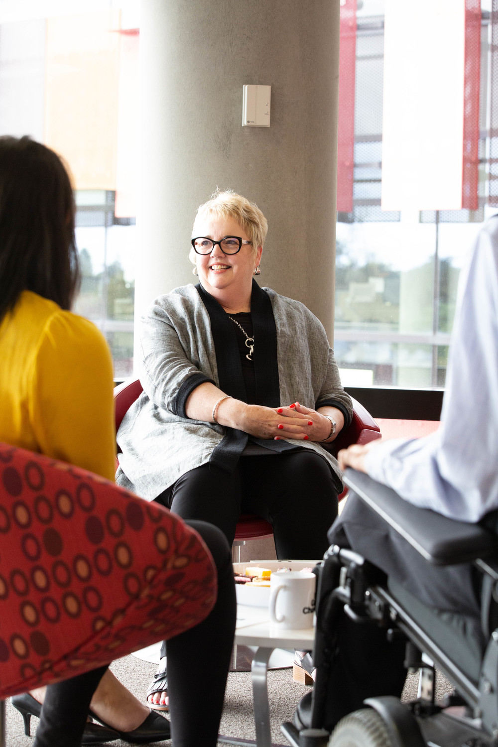 Woman in a wheelchair in a meeting