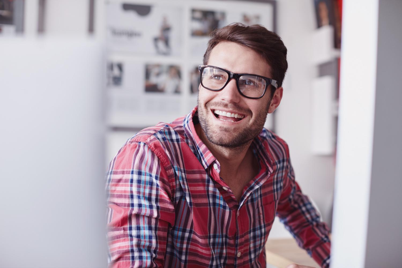 Man smiling at something off screen