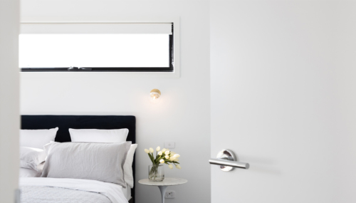 Bed with small window above with Russells blockout roller blind