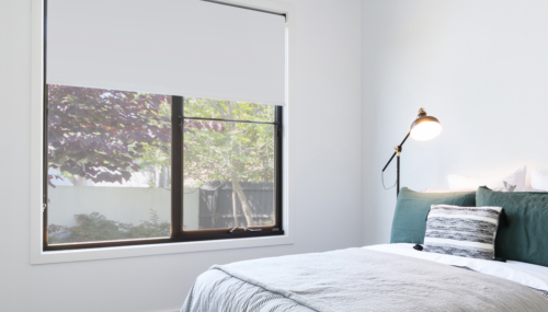 Bedroom with window and blockout roller blind