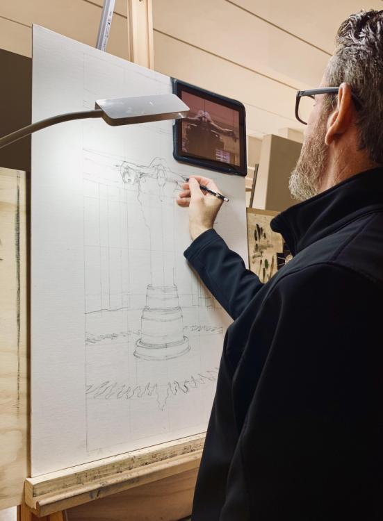 Cory uses a photo of the sculpture Sacrifice displayed on an iPad so he can zoom in and sketch the fine details of the artwork