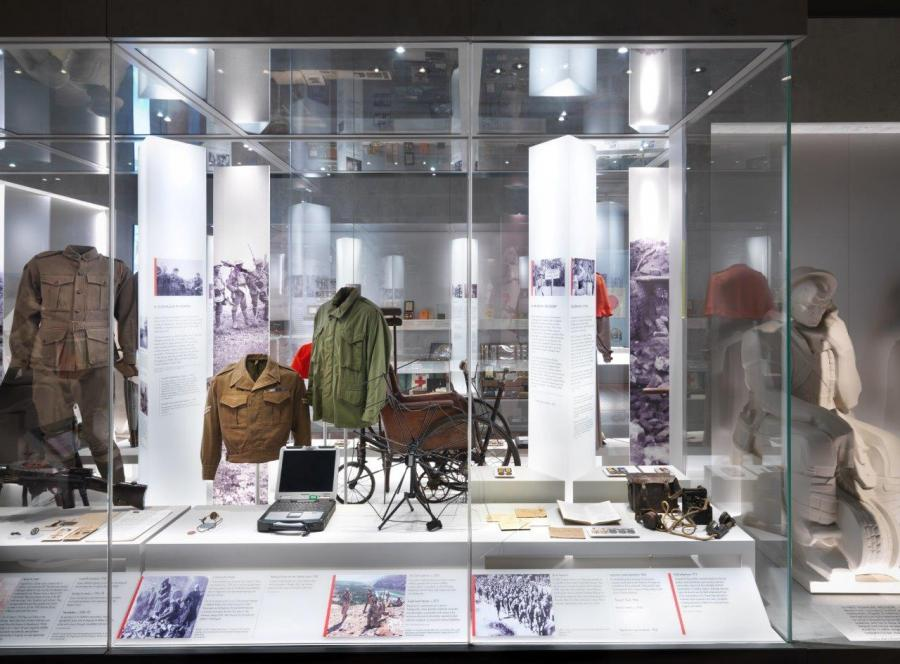 Eddie Wright's jackets (centre) on display at the Memorial's Centenary Exhibition