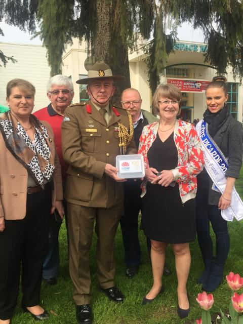 Madame Therese Dheygers, Mayor of Peronne; Colonel S E Clingan, Defence Attache Commemorations, and local dignitaries, pose with a soil sample collected from the Historial de la Grande Guerre (Museum of the Great War) in Peronne, France.
