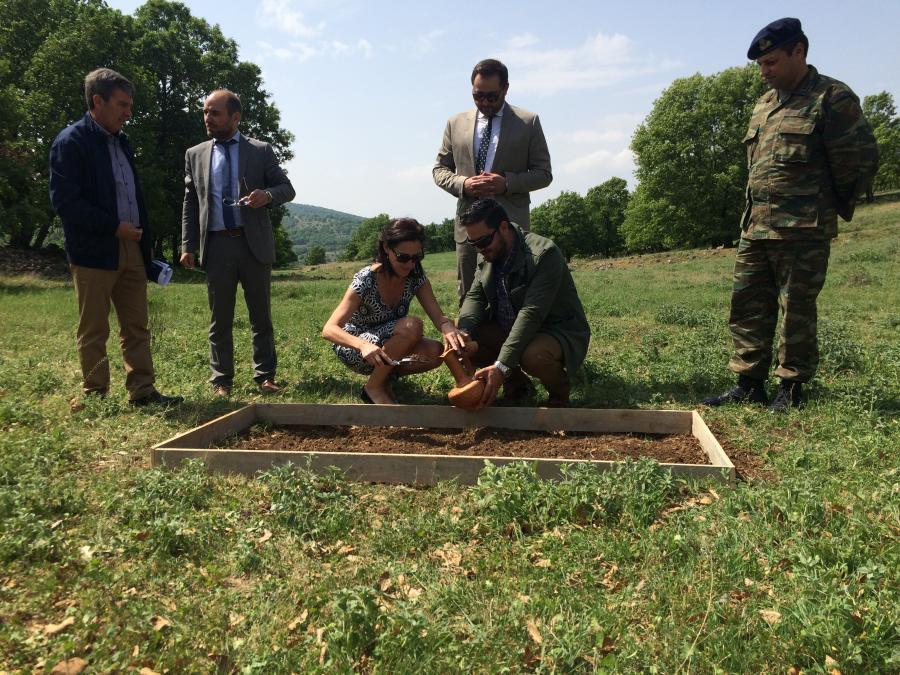 Mr Christos Bardakas, Deputy Mayor; Mr Nikolaos Doumtsis, Deputy Mayor; and Mr Petros Seridis, President of the Municipal Council collecting soil with local dignitaries in Bouzania, near to Vevi Pass, Greece.
