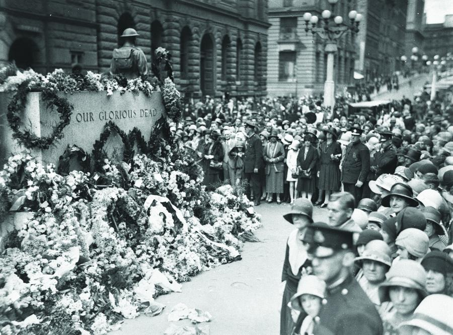 The Cenotaph covered in floral tributes on Anzac Day, 25 April 1930. Courtesy State Library of NSW