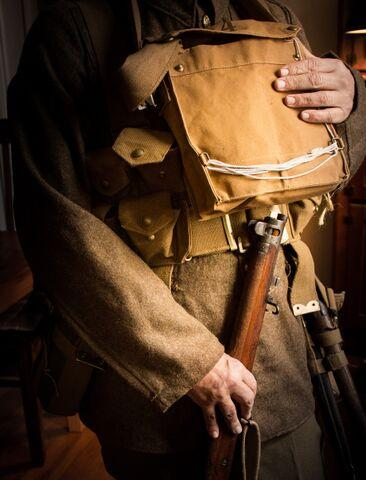 A bag containing a gas mask worn on the chest in what the Army called the 'ready' position.
