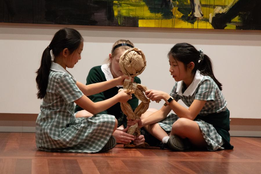 Stage 3 students creating their Anzac puppet with brown paper