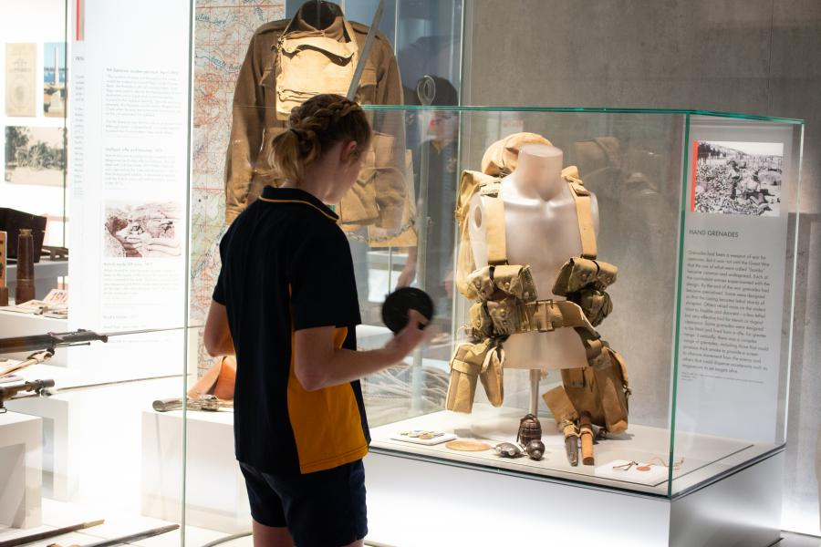 Stage 5 student viewing First World War memorabilia in the Centenary Exhibition