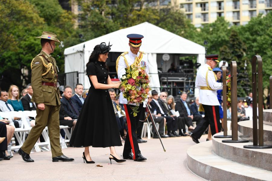 The Duke and Duchess approach the steps of the memorial to lay their wreath