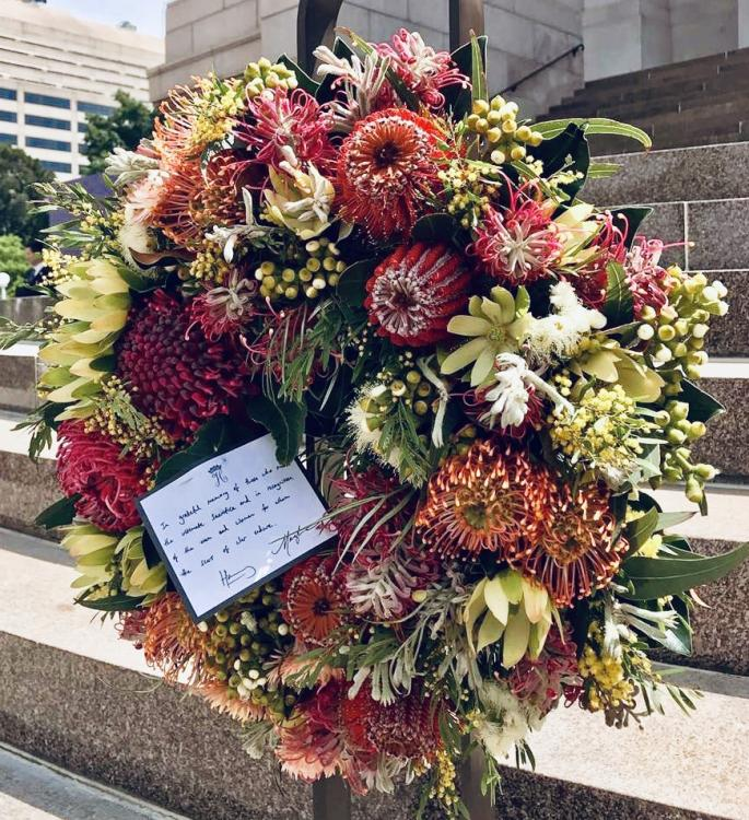 The wreath of Australian natives laid by the Duke and Duchess of Sussex. The accompanying card reads: In grateful memory of those  who made the ultimate and in recognition of the men and women for whom the scars of war endure. Harry Meghan
