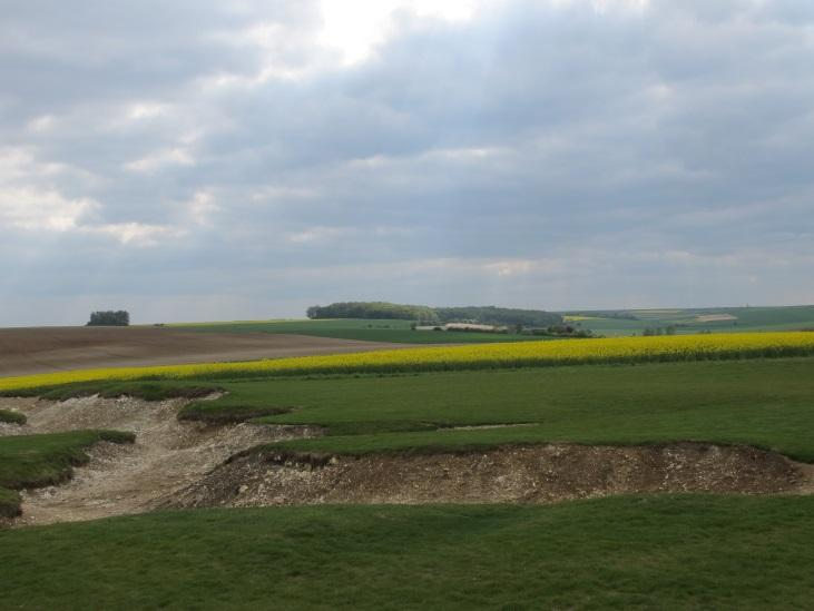 Typical low ridges and shallow valleys of the Somme countryside.  Remains of 1918 German trenches at Le Hamel are in the foreground